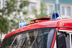 Two blue flashing lights on the roof of fire truck. Two blue flashing lights on the roof of a fire truck Royalty Free Stock Images