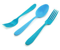 Two blue forks and spoon. Isolated on a white background Stock Photography
