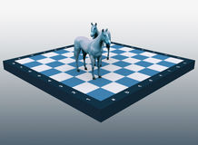 Two blue horses on a chess board Royalty Free Stock Image