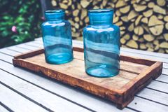 Two blue jars on the wooden tray Stock Photography