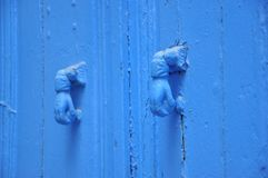Two blue knockers hand design, Tunisian blue door Stock Photography