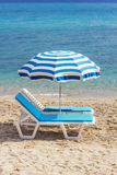 Two blue lounge chairs on a beach in Hanioti, Greece Royalty Free Stock Photo