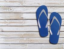 Two blue man lifestyle relax flip flops on white wooden floor Royalty Free Stock Images
