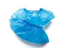 Two blue medical Shoe covers for feet isolated on white background. Hygiene and cleanliness in health facilities. Two blue medical shoe covers, overshoes stock photos