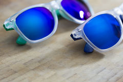 Two Blue mirror sunglasses on a wooden background Stock Photo