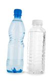 Two blue and noncolored bottle with water isolated Royalty Free Stock Photography