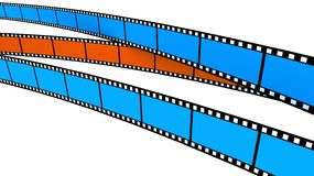 Two blue and one orange Film Stock Image