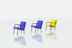 Two blue and one yellow chairs on white background Stock Image