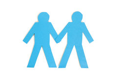 Two blue paper stick figures holding hands over white background Stock Image