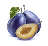Two blue plums and half  on white background Royalty Free Stock Image