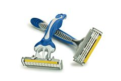 Two blue razor. On an isolated white background Royalty Free Stock Photo