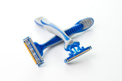Two blue razors Stock Photography