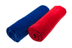 Two blue and red rolled up beach towel isolated Stock Photo
