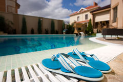 Two blue slippers. Near swimming pool in hotel Stock Photos