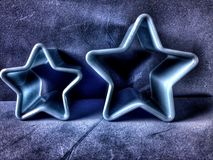 Two blue stars. Close view of two plastic stars of different Royalty Free Stock Images
