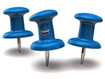 Two blue thumbtacks one fun thumbtack Stock Images