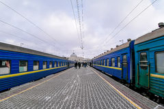 Two blue trains on train station platform in the winter Stock Images