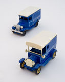 Two blue vintage delivery vans. The toy vans have allowed an image from an unusual angle of two very early delivery vehicles vector illustration