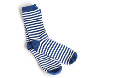 Two blue and white striped socks on white. Background Stock Photos