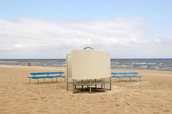 Blue wooden bench change cabin sea beach people Stock Photography