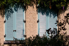 Two blue wooden shutters Stock Image