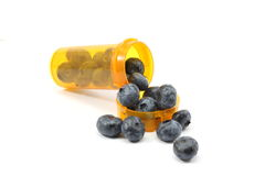 Two Blueberries Daily. Blue berries spilling out of a prescription rx bottle Royalty Free Stock Photo
