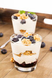 Two blueberry yoghurt desserts Stock Photos