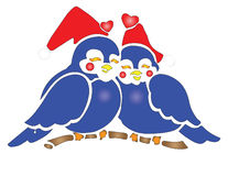 Two Bluebirds wearing Santa Hats Royalty Free Stock Photography
