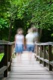 Two blurry girls walking Stock Photo