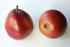 Two blush pears. Two red blush pears on a white background Royalty Free Stock Photos