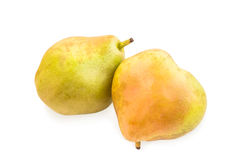 Two blushful ripe pears with spotty pear skin on white. Royalty Free Stock Photography