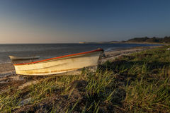 Two boat on the beach at sunset Stock Photography
