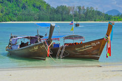 Two boat on the beach, Thailand. Pi Pi Island, Thailand - November 14: Crowded beach with tourists all over in winter November 14, 2010 on Pi Pi Island beach Stock Images