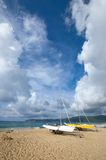Two boat docked at the beach. Two boat docked on the beach in Yalong Bay of Sanya City,China Royalty Free Stock Photo