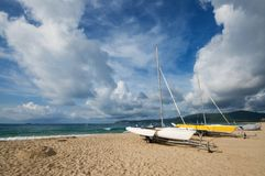 Two boat docked at the beach. Two boat docked on the beach in Yalong Bay of Sanya City,China Royalty Free Stock Photography