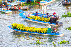 Two boat exchange trade flowers on river Royalty Free Stock Photos