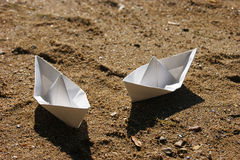 Two boat. Two paper boats on a sandy beach Royalty Free Stock Images