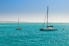 Two boats in azure bay Stock Photography