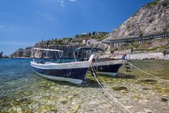 Two boats in a bay in Taormina in Sicily stock images