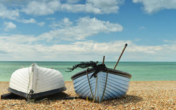 Two boats on the beach one upside-down Royalty Free Stock Images