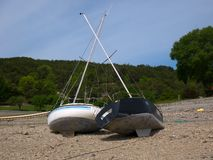 Two boats beached together. stock images