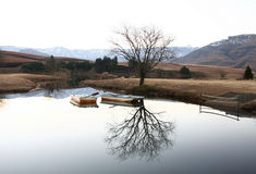 Two Boats on Castleburn Dam. Drakensberg, South Africa Royalty Free Stock Image