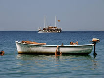 Two boats with children on sea. Children (best friends) on school vacation, enjoy, swimming, sunbathing, on a small white board, while at the horizon see a Stock Photos