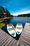 Two boats floating near pier Stock Image