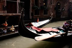 Two boats gondolas at Venetian canal, selective focus photo.  Royalty Free Stock Photography