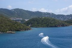 Two boats heading in to St Thomas Stock Image