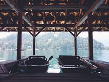Two boats inside a boathouse