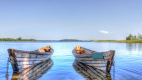 Two boats on the lake birch Stock Photography