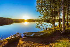 Two boats on a lake shore Royalty Free Stock Photo