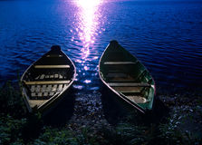 Two boats at moonlight. Two boats at night on moonlight royalty free stock photos